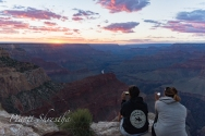 Two girls capture the Grand Canyon Sunset in their mobile devices